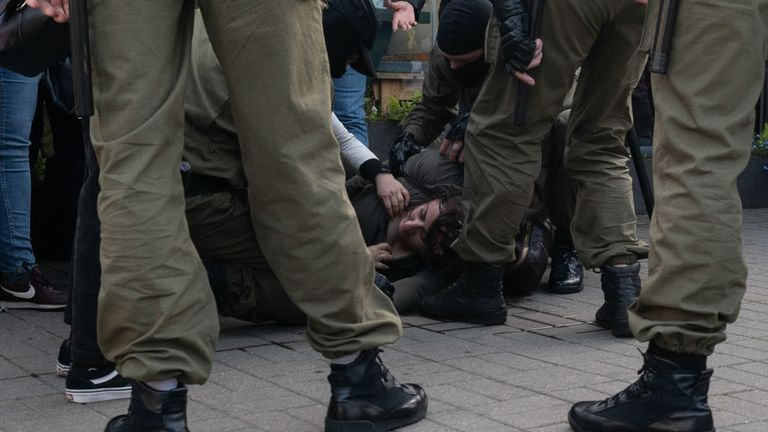 MINSK, BELARUS - SEPTEMBER 19: A woman suffers head injuries as peaceful protesters are encircled by police and arrested en masse during a women's march on September 19, 2020 in Minsk, Belarus. Women have been at the forefront of Belarus's protest movement following the disputed August 9th presidential election, which government critics allege was rigged in favor of current President Alexander Lukashenko. (Photo by Jonny Pickup/Getty Images)