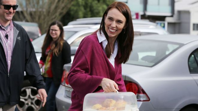 Jacinda Ardern arrives with scones as she visits Labour Election Day volunteers