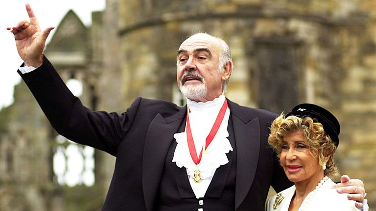 Sir Sean Connery, with wife Micheline (R), pose for photographers after he was formally knighted by .. Sir Sean Connery, with wife Micheline (R), pose for photographers after he was formally knighted by the Britain's [Queen Elizabeth] at Holyrood Palace in Edinburgh July 5. [The Scottish screen legend, famous for his role as James Bond, was honoured two years after he was reportedly denied a knighthood because of his passionate Scottish nationalism. ] DOWNLOAD PICTURE Date: 05/07/2000 12:00 Dime