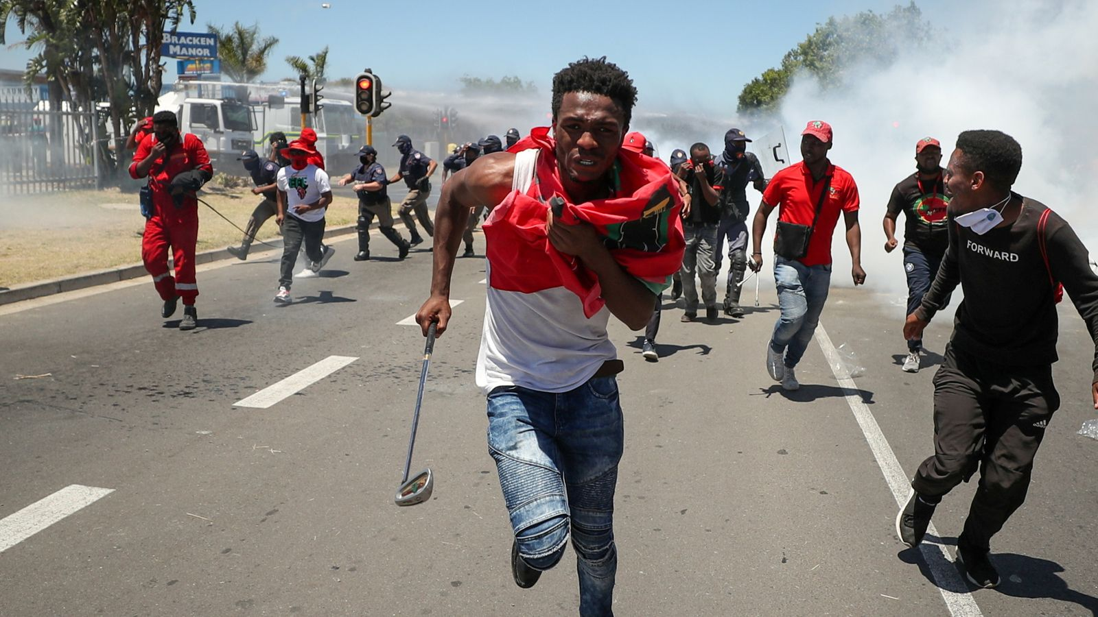 South African police use tear gas on 'whites-only' prom protesters