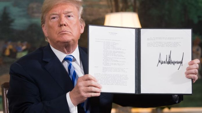 Donald Trump signed document restoring sanctions against Iran after announcing US withdrawal from Iran nuclear deal