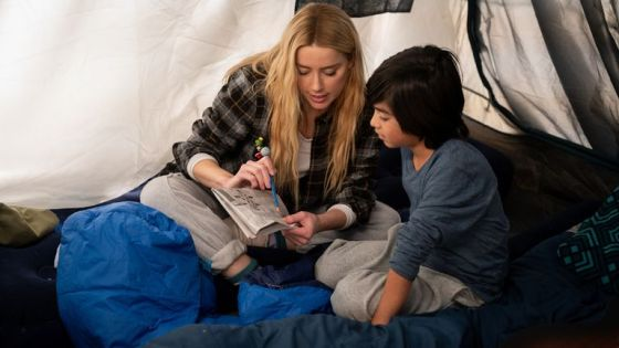 Amber Heard as Nadine Cross and Gordon Cormier as Joe In The Stand.  Pic: Robert Falconer / CBS