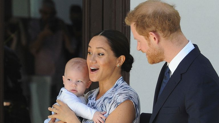 Britain's Prince Harry and Meghan, Duchess of Sussex, holding their son Archie, meets with Anglican Archbishop Emeritus, Desmond Tutu, and his wife Leah in Cape Town, South Africa, Wednesday, Sept. 25, 2019. The royal couple are on the third day of their African tour. (Henk Kruger/African News Agency via AP, Pool)