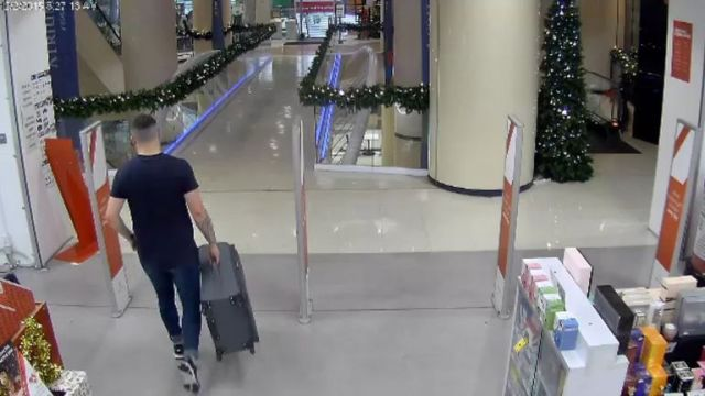 Kempson is seen buying a large suitcase from a store