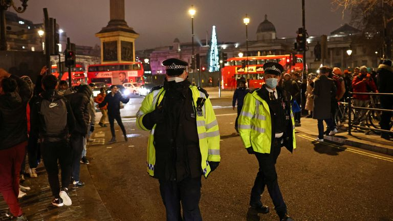 Police officers patrol during an anti-lockdown protest and a New Year's celebration, amid the outbreak of the coronavirus disease (COVID-19), in London, Britain January 1, 2021.
