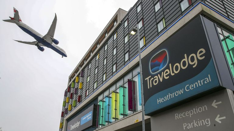 A plane passes over the Travelodge Hotel at Heathrow