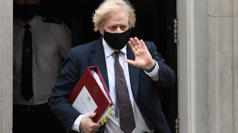 Prime Minister Boris Johnson leaves 10 Downing Street to attend Prime Minister's Questions at the Houses of Parliament in London