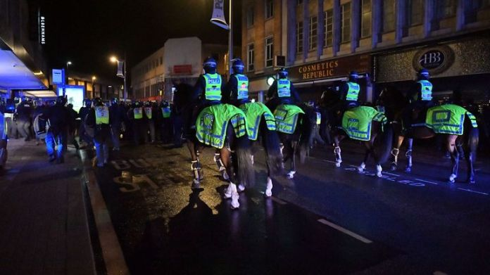 Tensions mounted as police wearing helmets and holding shields began calling on crowds to disperse