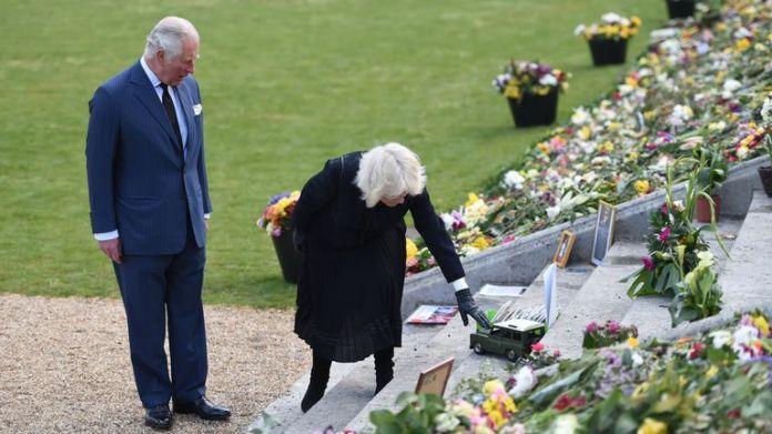 EMBARGOED UNTIL 1100 THURSDAY APRIL 15 The Prince of Wales and Duchess of Cornwall visit the gardens of Marlborough House, London, to see flowers and messages left by members of the public outside Buckingham Palace after the Duke's death Edinburgh April 10 Photo date: Thursday April 15, 2021.