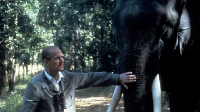 Prince Philip stroking an elephant in India. Pic: Anwar Hussein
