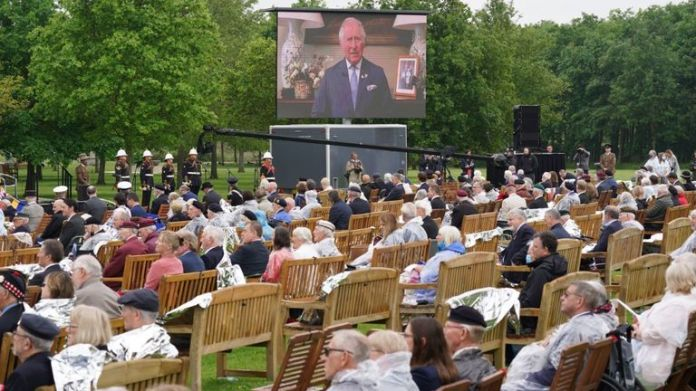 Veterans watch the official opening of the British Normandy Memorial in France via a live feed
