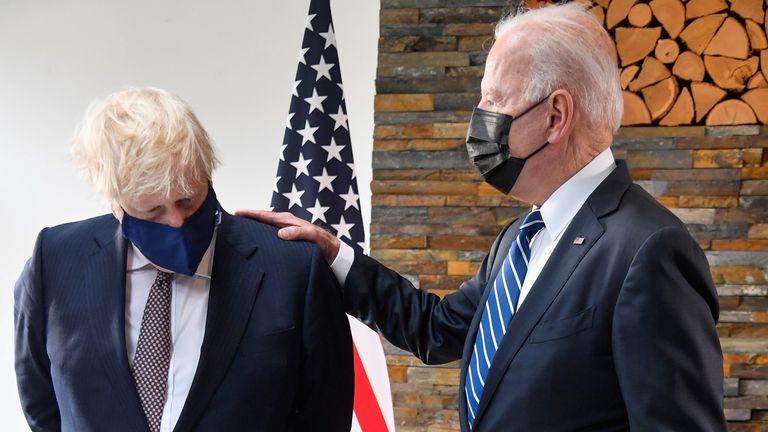 U.S. President Joe Biden speaks with Britain's Prime Minister Boris Johnson, as they look at historical documents and artefacts relating to the Atlantic Charter during their meeting, at Carbis Bay Hotel, Carbis Bay, Cornwall, Britain June 10, 2021. REUTERS/Toby Melville/Pool