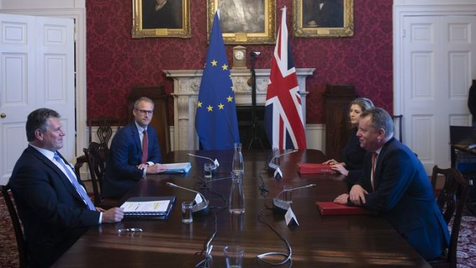 Brexit minister Lord Frost, flanked by Paymaster General Penny Mordaunt, sitting opposite European Commission vice president Maros Sefcovic, who is flanked by Principal Adviser, Service for the EU-UK Agreements (UKS) Richard Szostak, as he chairs the first EU-UK partnership council at Admiralty House in London