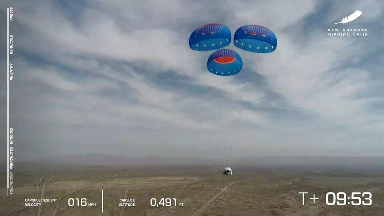 The New Shepard capsule is seen using parachutes to land during a test in Texas in April.  Photo: AP