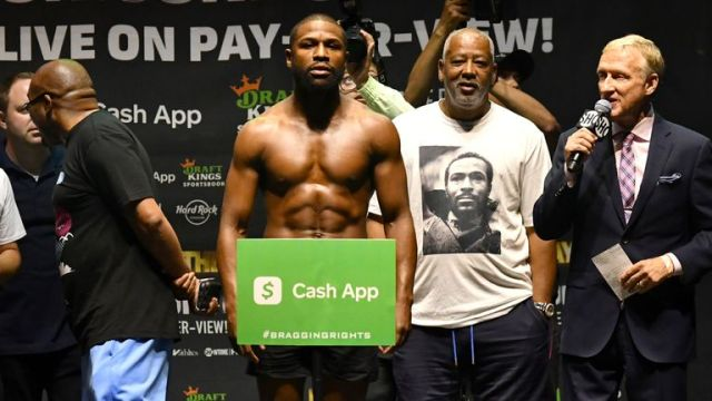 Floyd Mayweather poses for photographers during a weigh-in Saturday, June 6, 2021, in Hollywood, Fla. Mayweather will fight Logan Paul in an exhibition boxing match at Hard Rock Stadium in Miami Gardens, Fla. Sunday. (AP Photo/Jim Rassol)