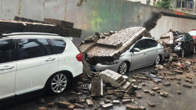 Debris of collapsed wall caused by heavy rainstorm damages 7 cars in Zhengzhou city, central China's Henan province, 20 July 2021. (Imaginechina via AP Images)