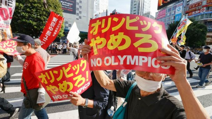 It hasn't been all celebration in Japan ahead of the official start of the Olympic games, with people protesting in Tokyo's Shibuya district, calling for the games to be cancelled. Pic AP