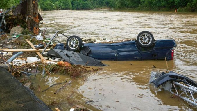 A destroyed car lies in the Ahr river in the village in the district of Ahrweiler. Pic: Thomas Frey/picture-alliance/dpa/AP