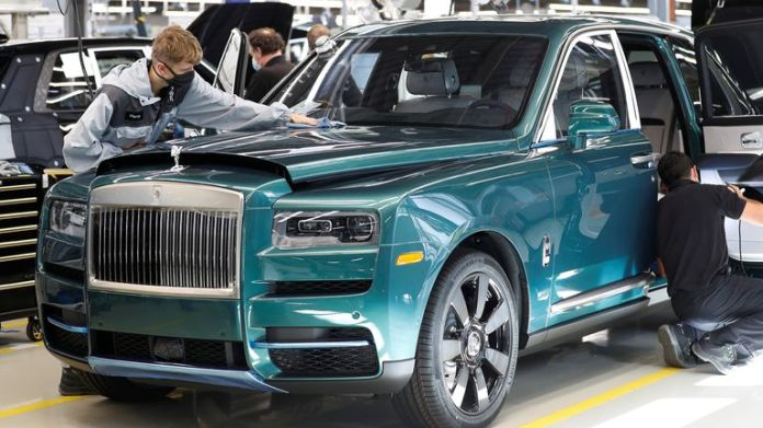 Technicians inspect a Rolls-Royce a car on the production line of the Rolls-Royce Goodwood factory, near Chichester, Britain, September 1, 2020