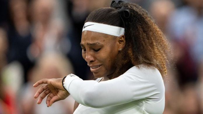 Tennis - Wimbledon - All England Lawn Tennis and Croquet Club, London, Britain - June 29, 2021 Serena Williams of the U.S. reacts after sustaining an injury before retiring from her first round match against Belarus' Aliaksandra Sasnovich Pool via REUTERS/Jed Leicester