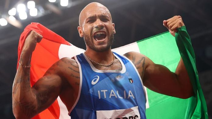 Lamont Marcell Jacobs celebrates after winning Olympic gold