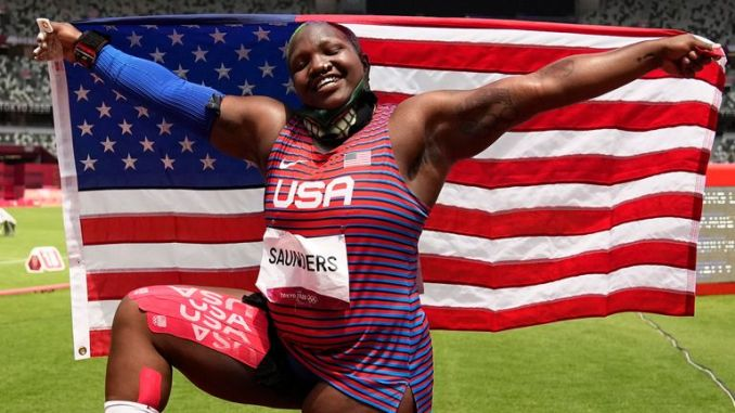 Raven Saunders, posed with the US flag after finishing second