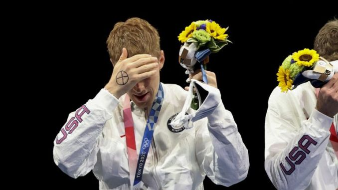 US fencer Race Imboden (L) with a cross on his right hand
