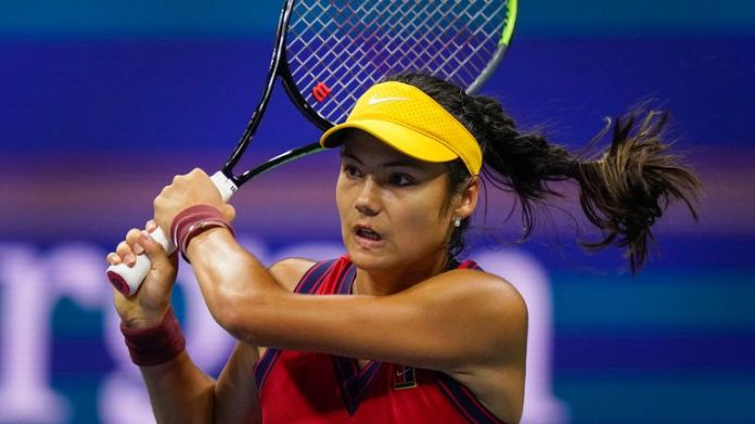 Emma Raducanu, of Great Britain, returns a shot to Maria Sakkari, of Greece, during the semifinals of the US Open tennis championships, Thursday, Sept. 9, 2021, in New York. (AP Photo/Frank Franklin II