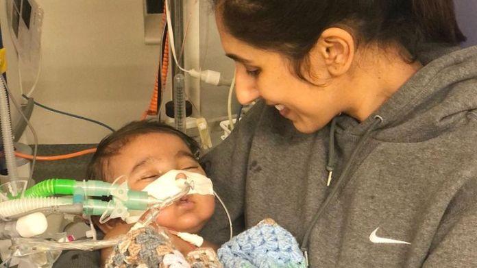Harvey and mum Karen Bahia in hospital