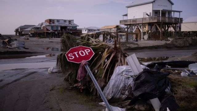 A stop sign lies damaged at a street corner in the aftermath of Hurricane Ida in Grand Isle, Louisiana, U.S., September 2, 2021. REUTERS/Adrees Latif