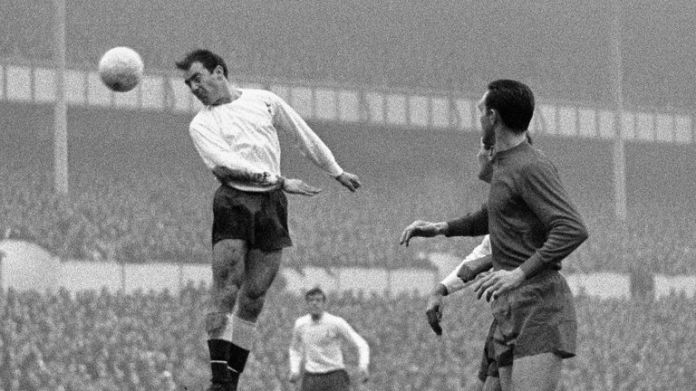 Jimmy Greaves leaps for a ball and scores in Spur's match against West Bromwich at White Heart Lane in December 1966