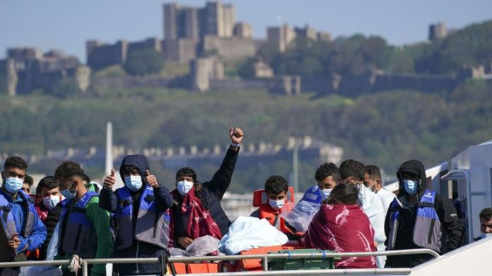 A group of people thought to be migrants are brought in to Dover, Kent