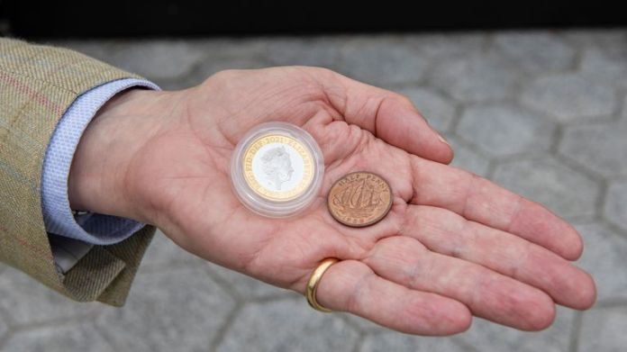 Richard Woodman-Bailey with the new £2 Britannia coin he'll place. Pic: Royal Mint