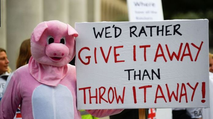 Workers in the British pig farming sector protest outside of the annual Conservative Party conference, in Manchester, Britain, October 4, 2021. REUTERS/Toby Melville