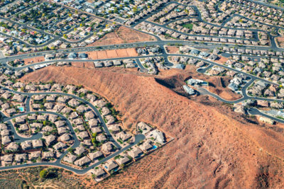 St. George, Utah has grown rapidly, with subdivisions and golf courses that push into the desert. The population has grown from 20,000 to 150,000 over the past 20 years.