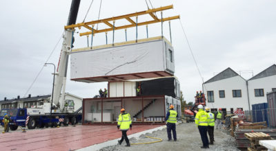 A prefabricated section of the Power of 10 development in Sweden being lifted into place.