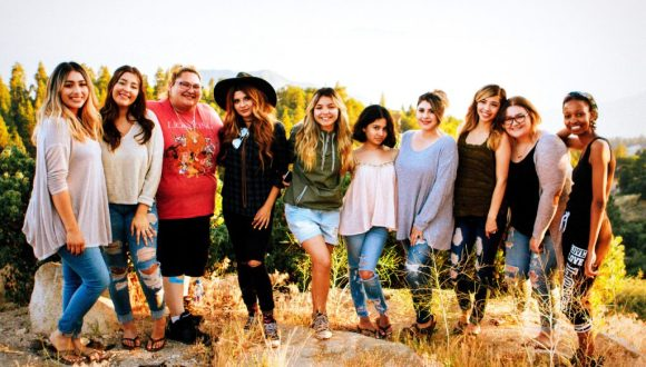 A diverse group of young women in a rural setting
