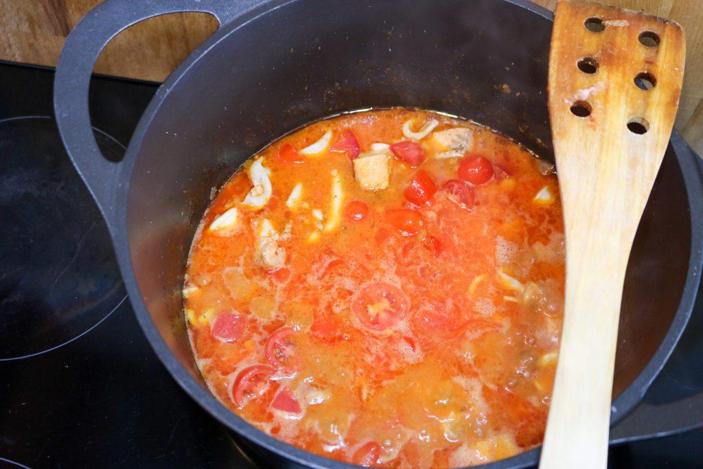 Tuscan Seafood Stew Adding Tomatoes