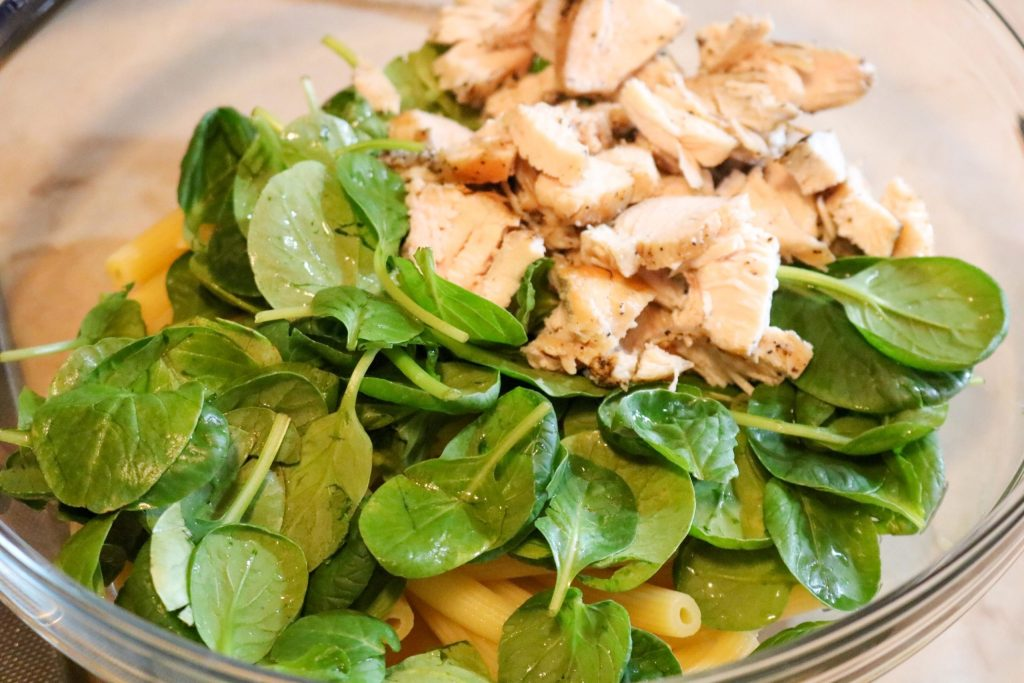 Mix greens, chicken, and pasta