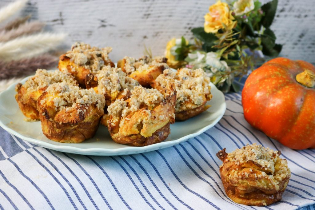 Top the muffins with the streusel and bake