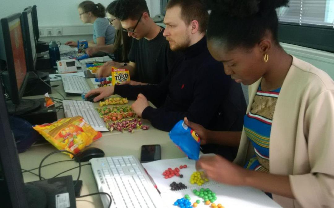 EAGLE students coding with sweets