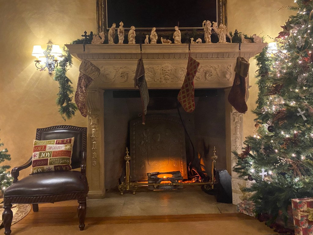 chair and fireplace with Christmas decorations