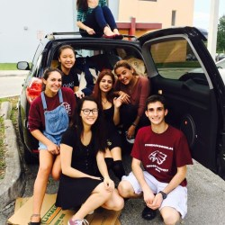 (From left to right) Morgan Schreiber, Kathy Liu, Joanna Zhuang, Jessie Sinitch, Sam Maldonado, Keila Velasquez, and Kathy Liu fill three cars with clothing donations.