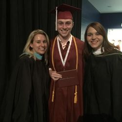 Senior Zack Kaufman poses with two of his former teachers before the ceremony begins.