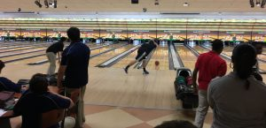 Senior Scott Hafetz looks on as the bowling ball approaches the pins. Photo courtesy of Richard Doan
