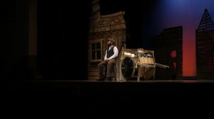 "Junior Alex Wind plays Tevye in ""Fiddler on the Roof."" Photo by Ryan Deitsch"