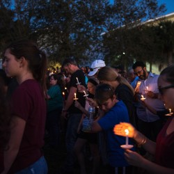 Students, teachers and families alike came to the sunset vigil to remember those directly affected by the shooting. Photo by Delaney Tarr