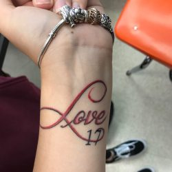 Students get tattoos to honor the 17 victims