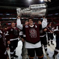 Assistant captain Tyler Avron hoists the Stanley Cup after the Eagles win their first state championship.
