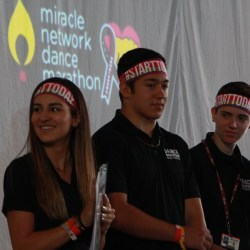 Senior Angelique Meneses and juniors Ethan Rocha and Drew Schwartz get ready to present the final donation total at Dance Marathon on April 2_. Photo by Rebecca Schneid.